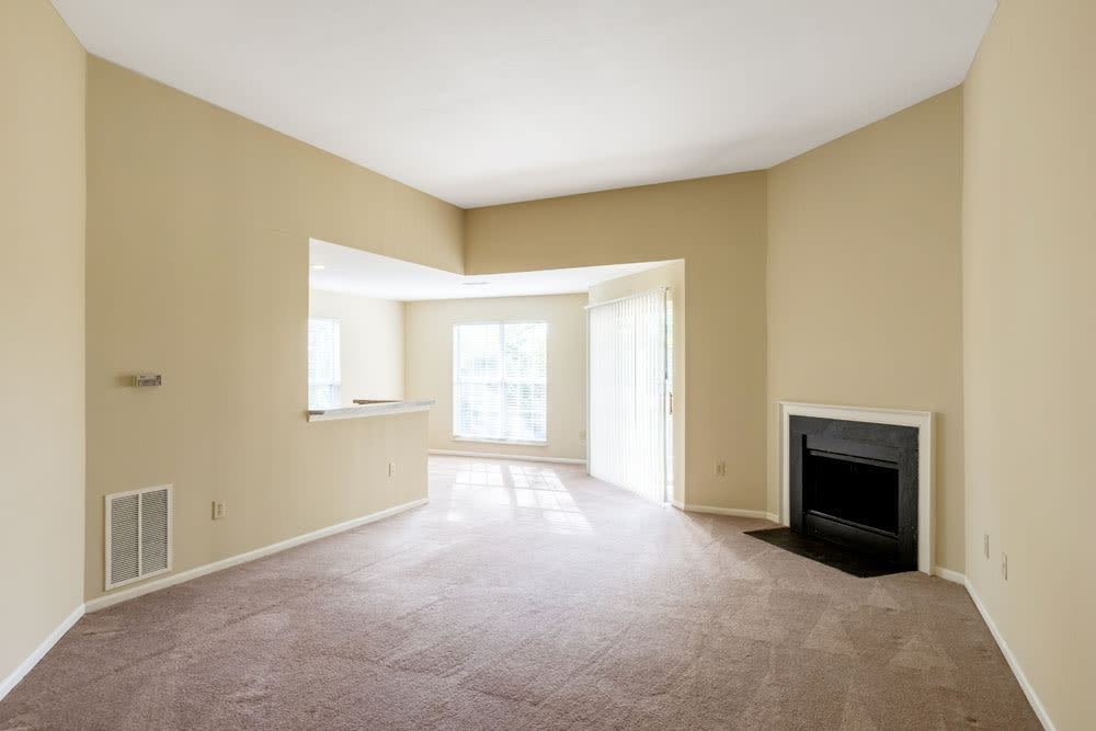 Empty model living room with a fireplace at Sycamore Ridge in Dublin, Ohio