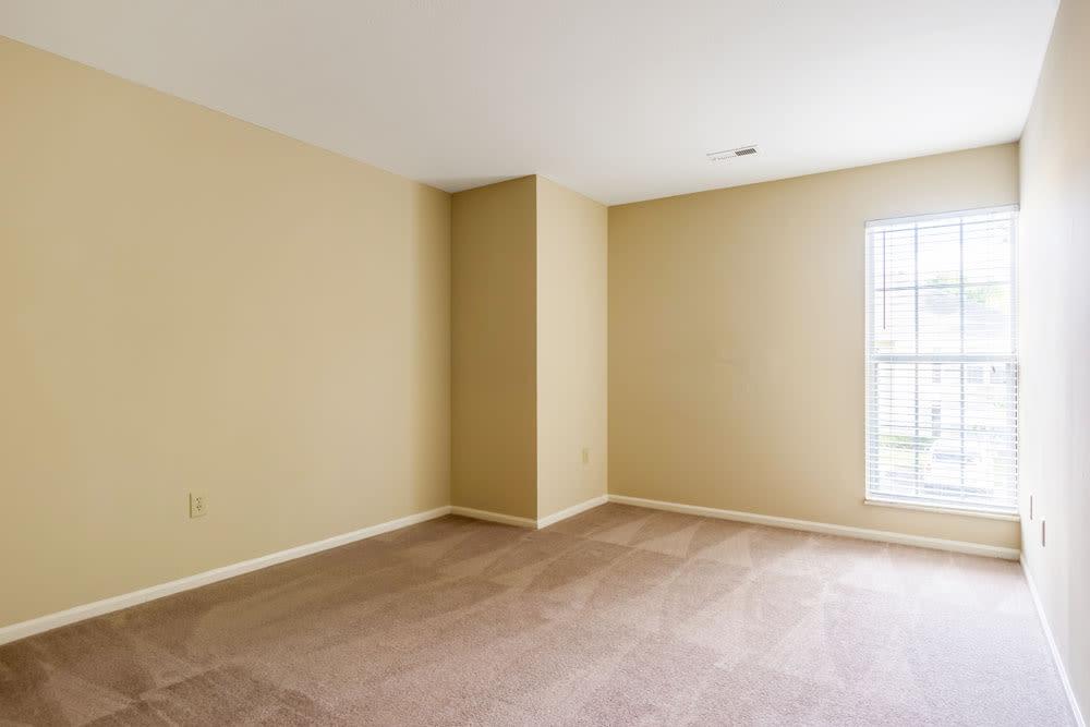Empty model bedroom with plenty of natural light at Sycamore Ridge in Dublin, Ohio