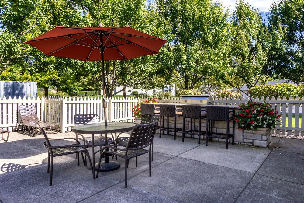 Outdoor barbecue area poolside at Sycamore Ridge in Dublin, Ohio