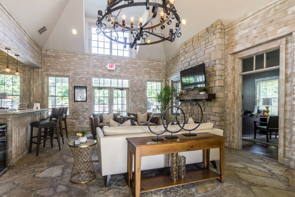 Clubhouse lounge with a brick interior and modern decor at Sycamore Ridge in Dublin, Ohio