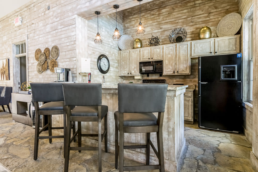 Bar seating and kitchen In the Clubhouse at Sycamore Ridge in Dublin, Ohio