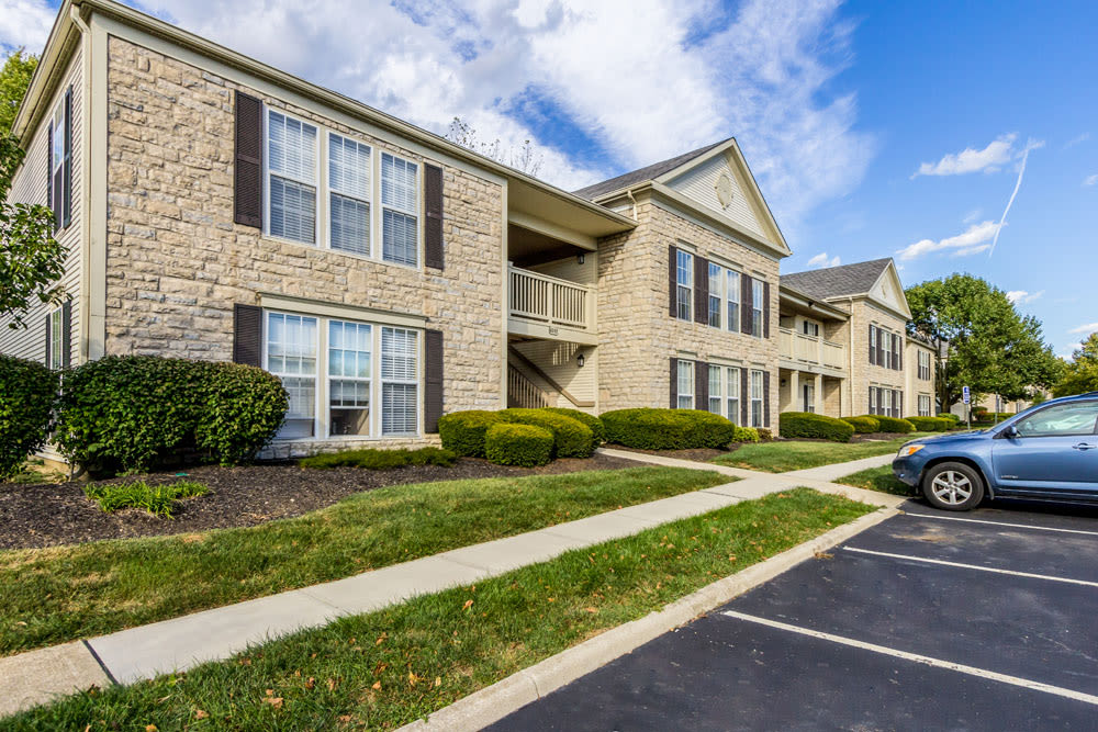Exterior view of complex and parking at Sycamore Ridge in Dublin, Ohio