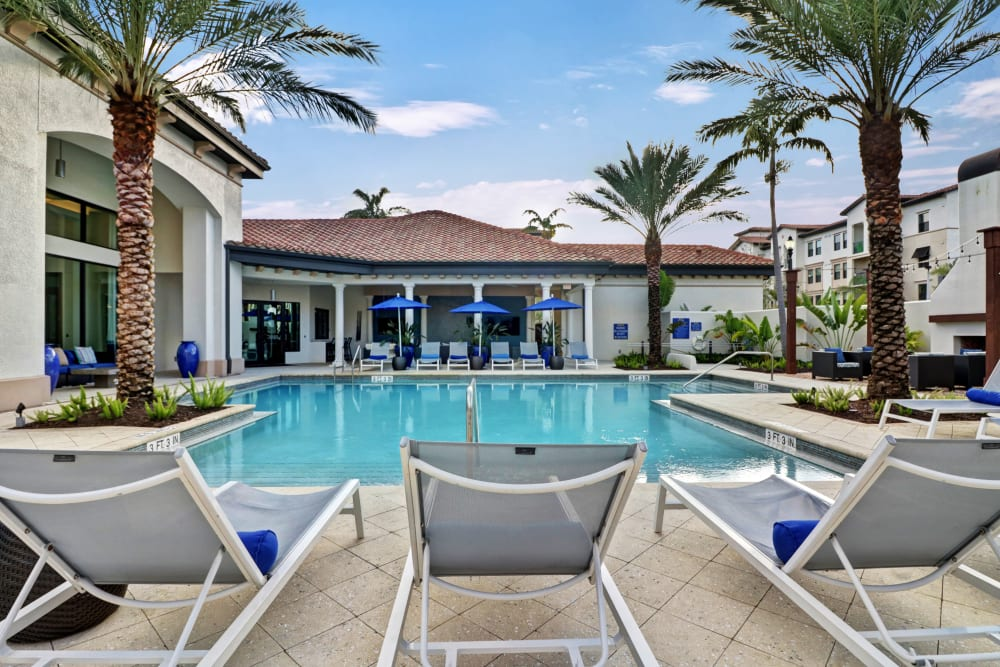 Lounge chairs by community pool at Linden Pointe in Pompano Beach, Florida