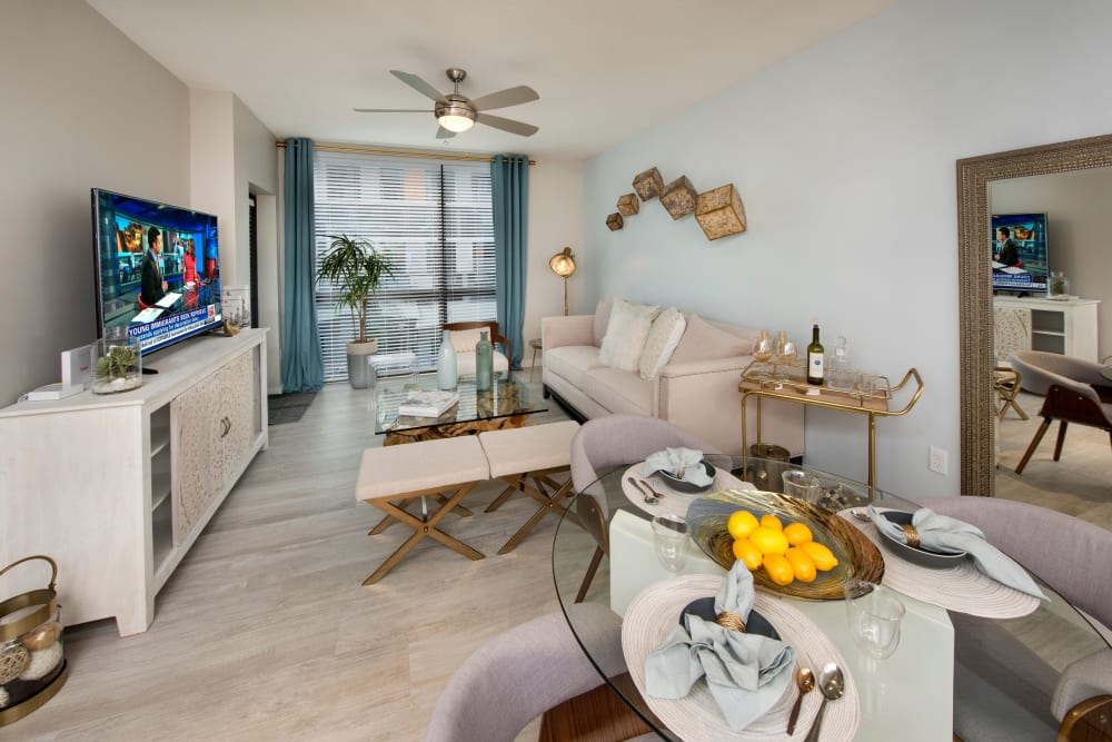 Dining nook and living room view in model home at The Flats in Doral, Florida