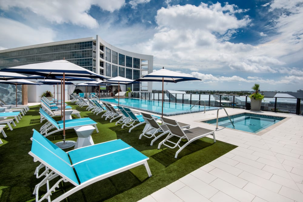 Resort style rooftop pool with lounge chairs at The Flats in Doral, Florida