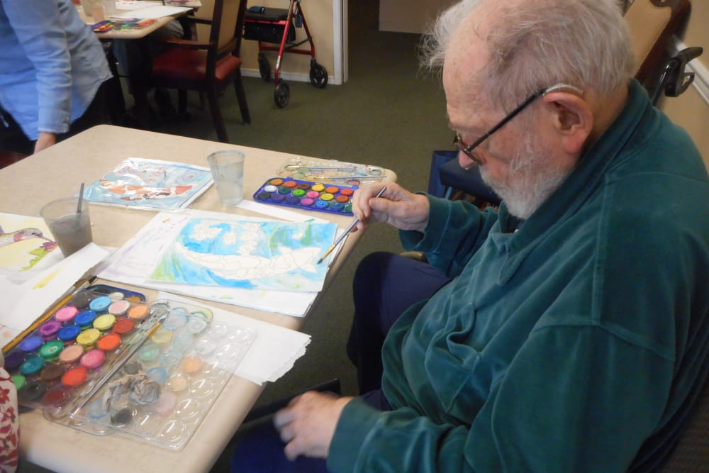 A resident painting at Patriots Glen in Bellevue, Washington.