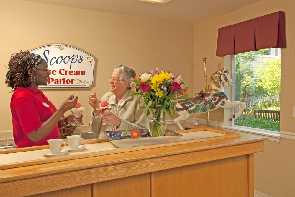 A resident and staff member eating ice cream at Patriots Glen in Bellevue, Washington.