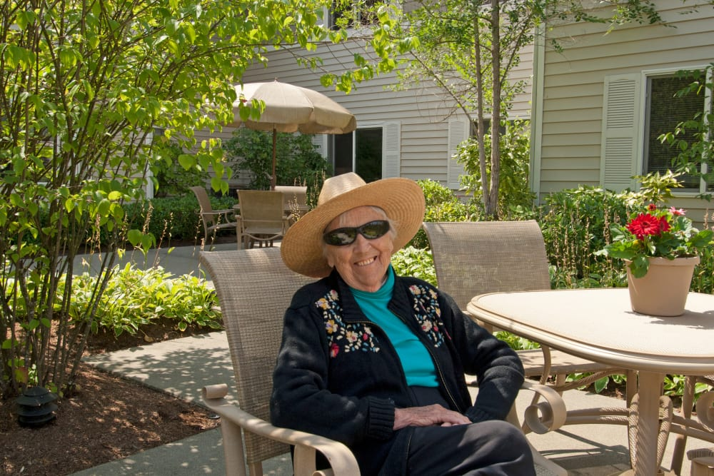 A resident enjoying the weather outside at Patriots Glen in Bellevue, Washington.