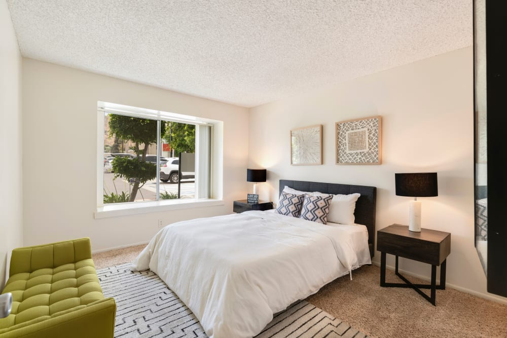 Well decorated model bedroom with plenty of natural light at The Heights at Grand Terrace in Grand Terrace, California