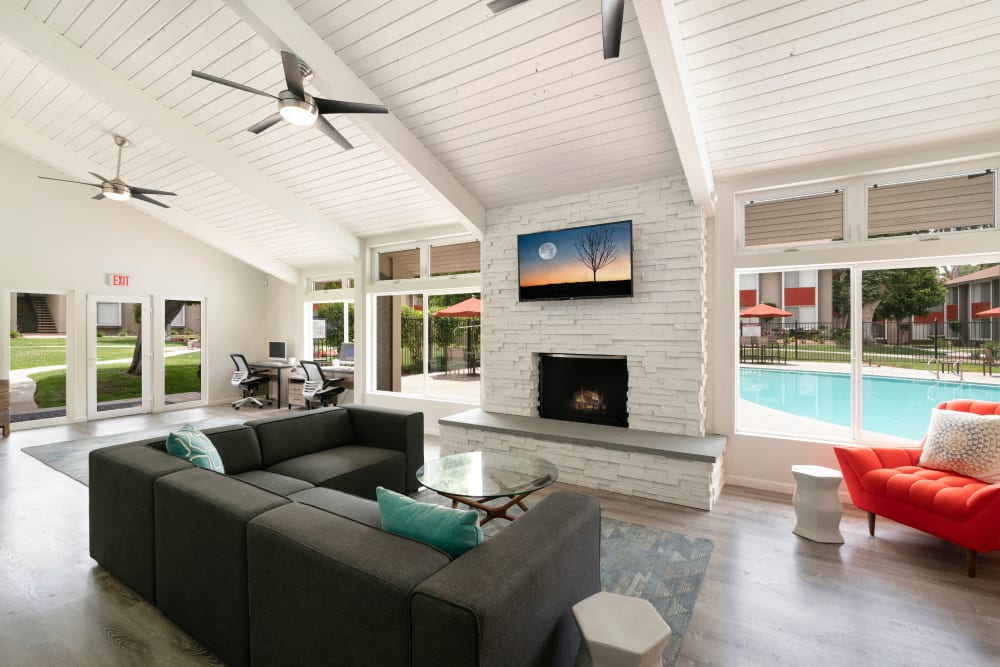 Poolside clubhouse with modern decor and ceiling fans at The Heights at Grand Terrace in Grand Terrace, California