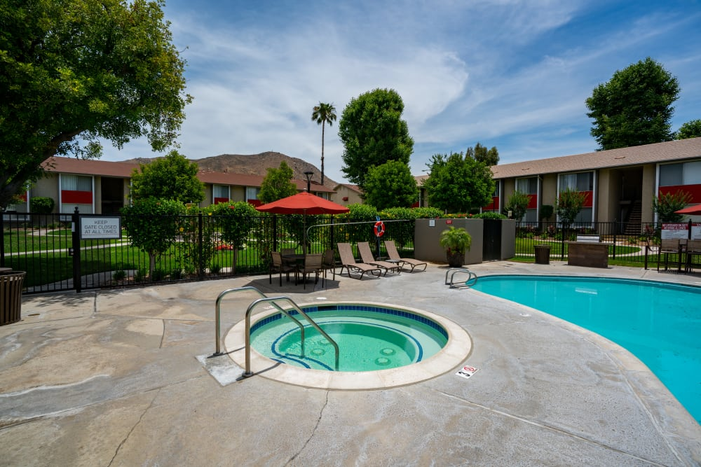 Hot tub and shaded seating available poolside at The Heights at Grand Terrace in Grand Terrace, California