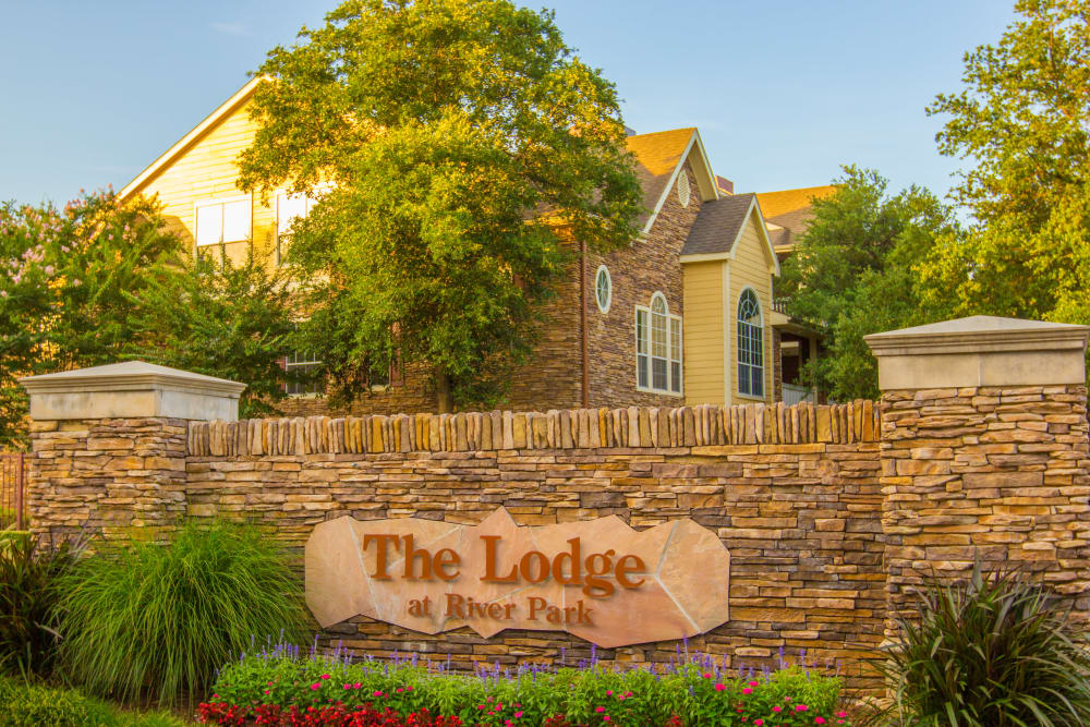 Front entrance sign at The Lodge at River Park in Fort Worth, Texas