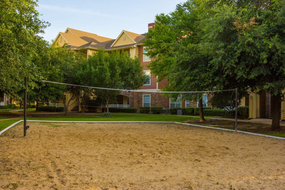 Outdoor volleyball court at The Lodge at River Park in Fort Worth, Texas