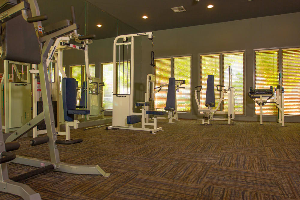 Weight machines in the fitness center at The Lodge at River Park in Fort Worth, Texas
