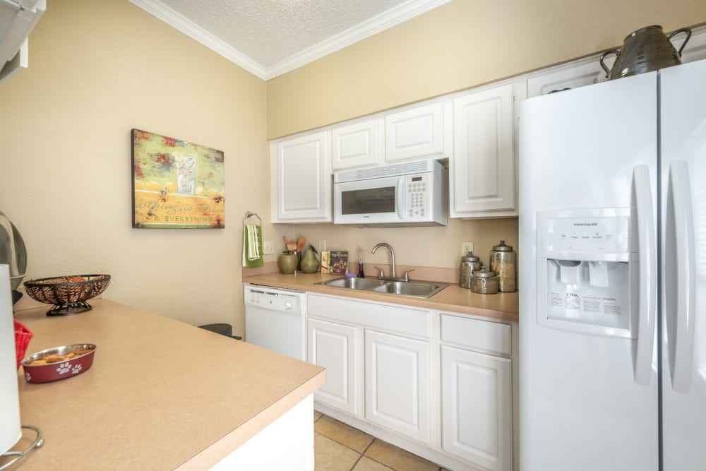 Clubhouse kitchen available for residents at The Madison in Dallas, Texas