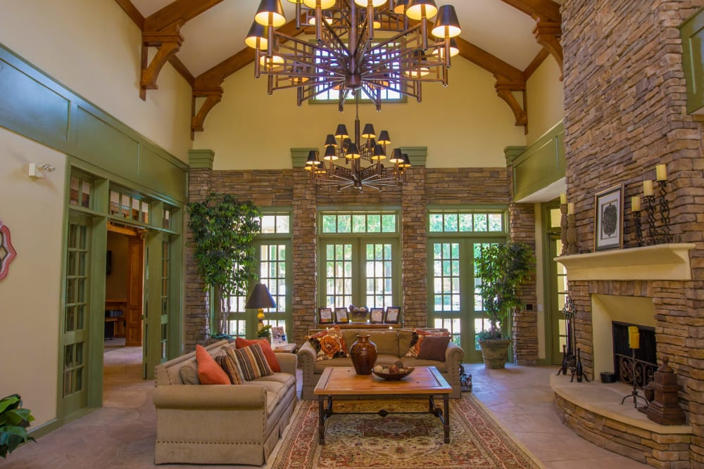 Clubhouse for residents with brick interior and fireplace at The Lodge at River Park in Fort Worth, Texas