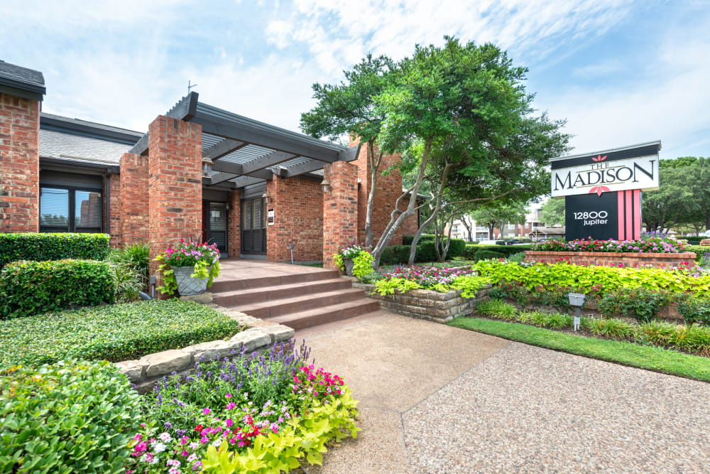 Beautiful landscape at the exterior leasing office at The Madison in Dallas, Texas