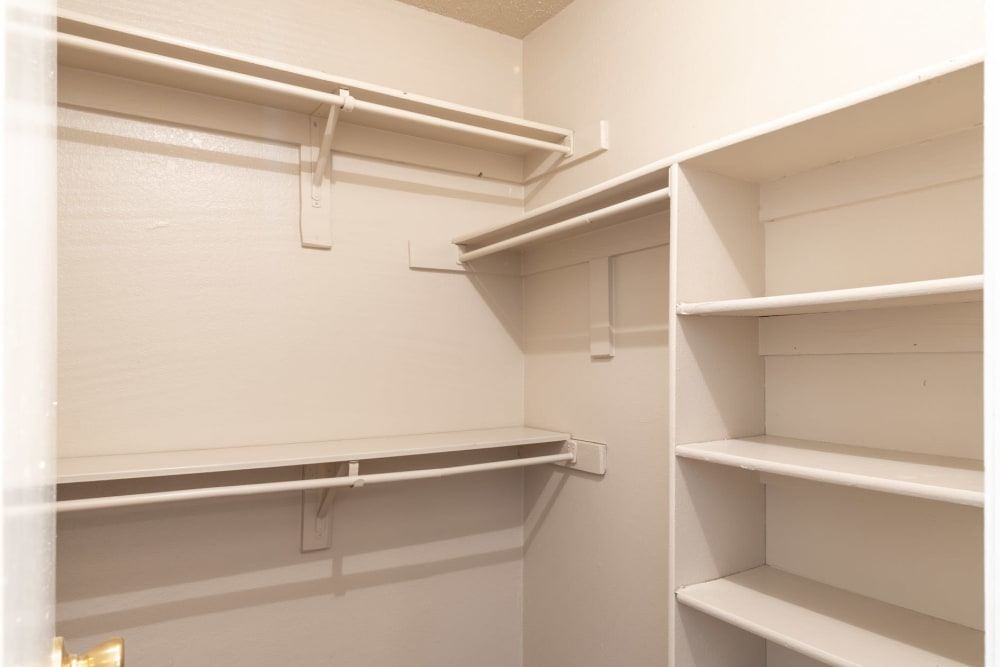 Walk in closet with plenty of shelves at The Madison in Dallas, Texas