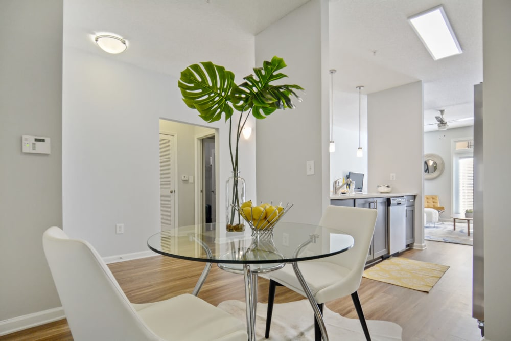 Dining area with a partial view of the kitchen in a model apartment at Ellington Midtown in Atlanta, Georgia