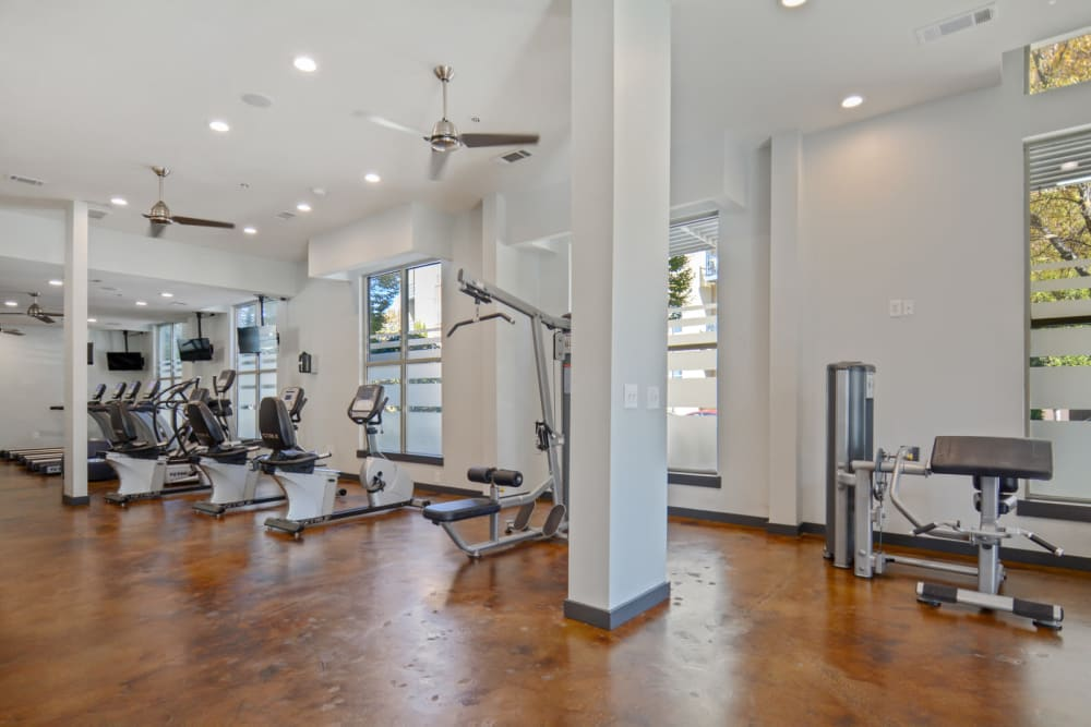 High ceilings and ample exercise equipment at the onsite fitness center at Ellington Midtown in Atlanta, Georgia