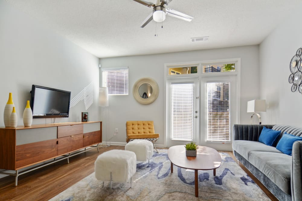 Ceiling fan an modern furnishings in the living area of a model home at Ellington Midtown in Atlanta, Georgia