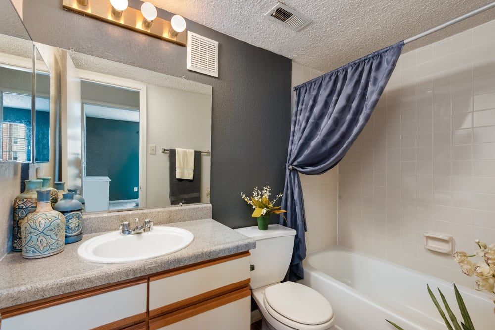 Model bathroom with a oval tub and large vanity mirror at The Mansion in Independence, Missouri