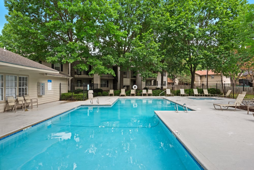 Resort style pool with wooded back drop at The Mansion in Independence, Missouri