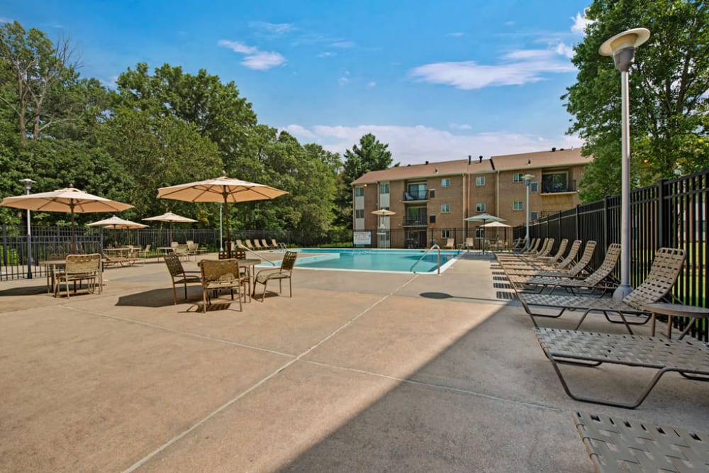 Community pool at Heritage Woods in Bel Air, Maryland features lounge chairs and other comfortable sitting areas