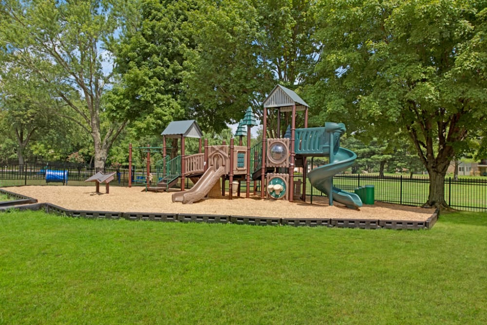 The playground at Howard Crossing in Ellicott City, Maryland features a soft playing surface