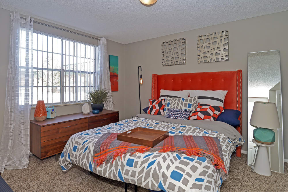 Model bedroom with large windows at Ten 30 and 49 Apartments in Broomfield, Colorado