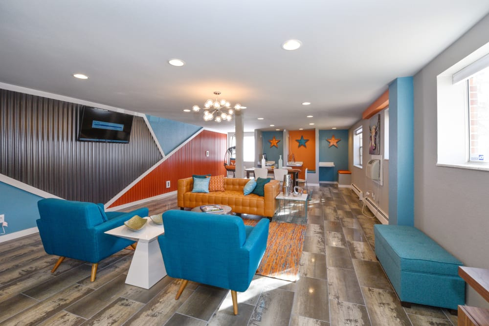 Well decorated clubhouse with plenty of seating at Ten 30 and 49 Apartments in Broomfield, Colorado