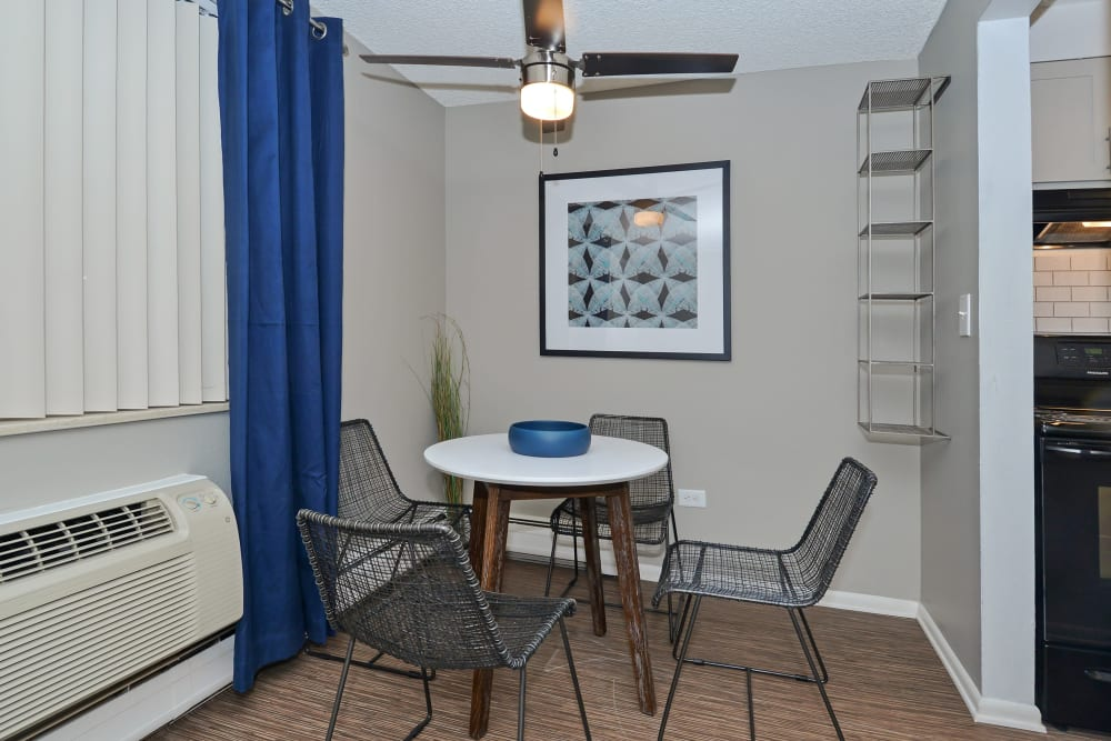 Dining nook with ceiling fan at Ten 30 and 49 Apartments in Broomfield, Colorado
