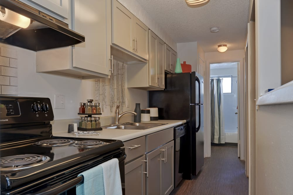 Model kitchen with Hardwood floors at Ten 30 and 49 Apartments in Broomfield, Colorado