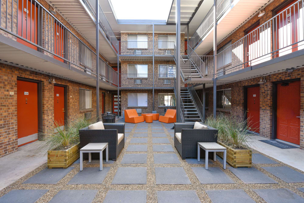 Couches and side tables in the courtyard at Ten 30 and 49 Apartments in Broomfield, Colorado