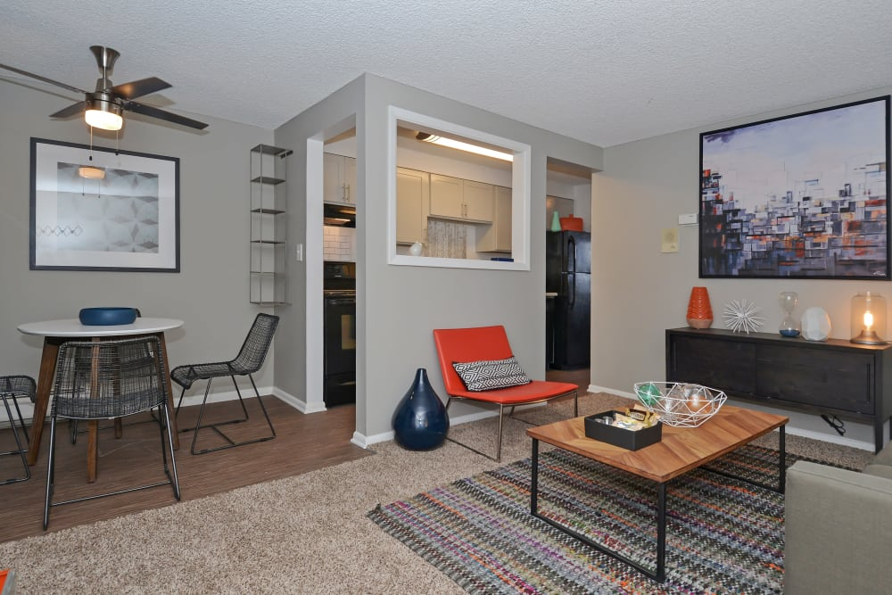 View of dining nook and kitchen bar from living room at Ten 30 and 49 Apartments in Broomfield, Colorado