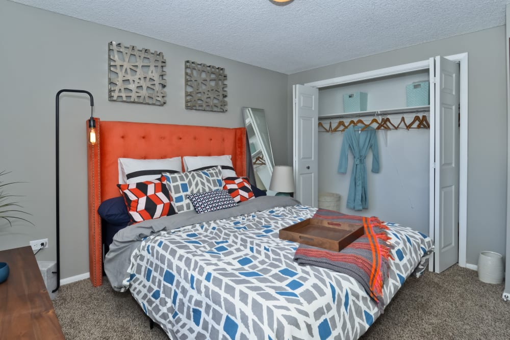 Well decorated model bedroom at Ten 30 and 49 Apartments in Broomfield, Colorado
