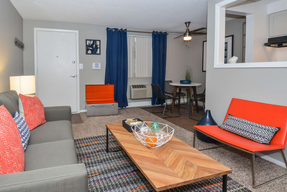 Living room with modern Decor and a view of the dining nook at Ten 30 and 49 Apartments in Broomfield, Colorado