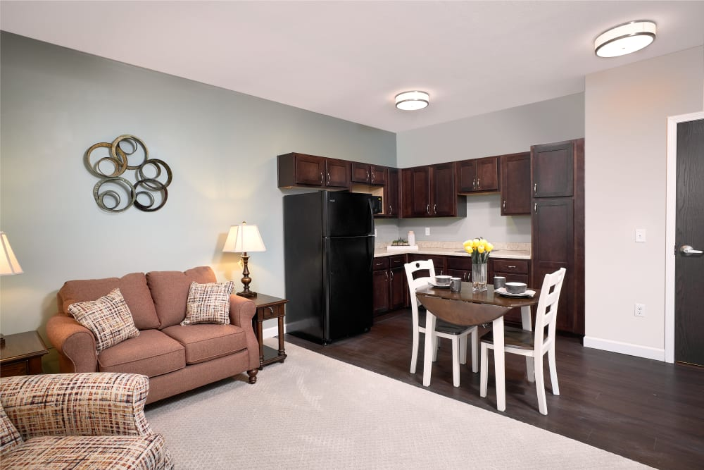 resident living area with kitchen and dining table