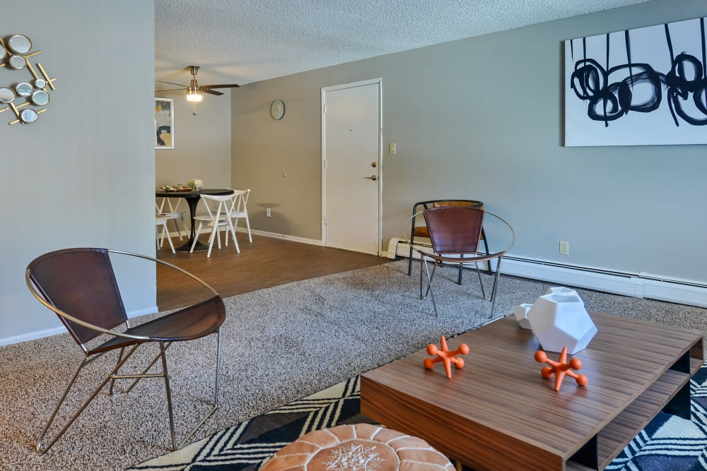 Model living room with view of dining nook at Ten 30 and 49 Apartments in Broomfield, Colorado
