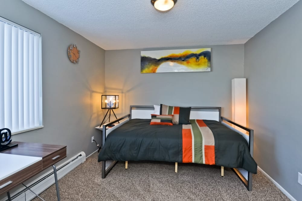 Model bedroom with plenty of natural light at Ten 30 and 49 Apartments in Broomfield, Colorado