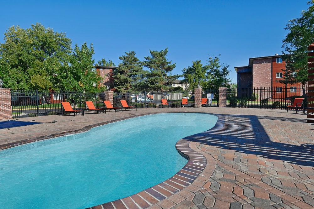 Sparkling swimming pool on a sunny day at Ten 30 and 49 Apartments in Broomfield, Colorado