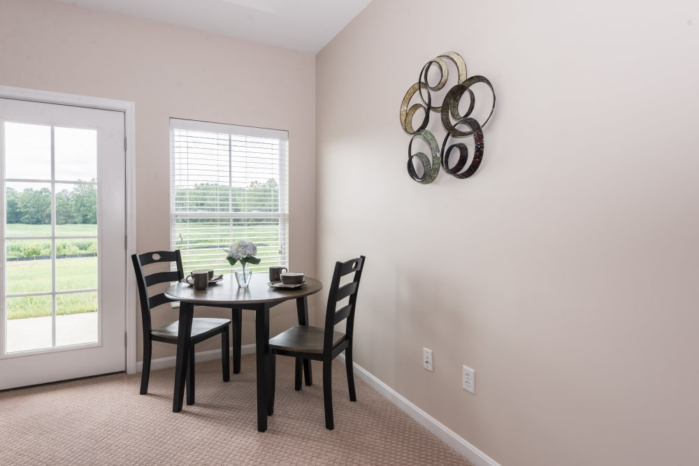 A dining room table next to a window at Legacy Living Florence in Florence, Kentucky