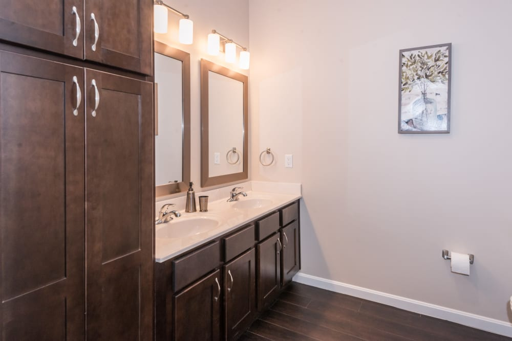Cabinet space and a double sink in an apartment bathroom at Legacy Living Florence in Florence, Kentucky