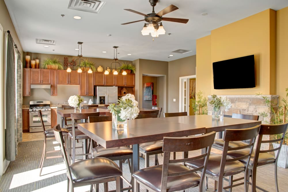 View of the dining area and kitchen in the Clubhouse at The Gates of Deer Grove in Palatine, Illinois