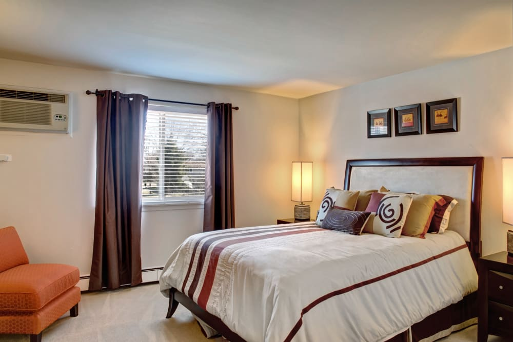 Plenty of natural light in the decorated model bedroom at The Gates of Deer Grove in Palatine, Illinois