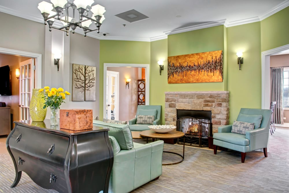 Clubhouse lounge with fireplace at The Gates of Deer Grove in Palatine, Illinois