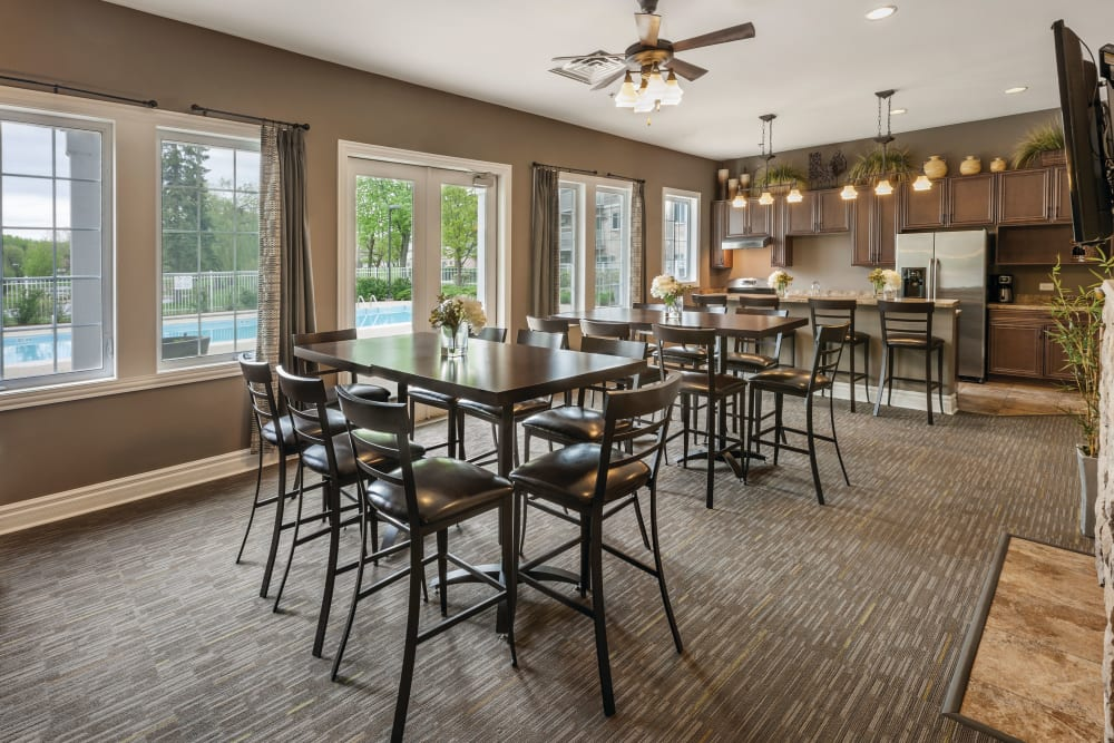 Dining area with large windows looking outside in the clubhouse at The Gates of Deer Grove in Palatine, Illinois