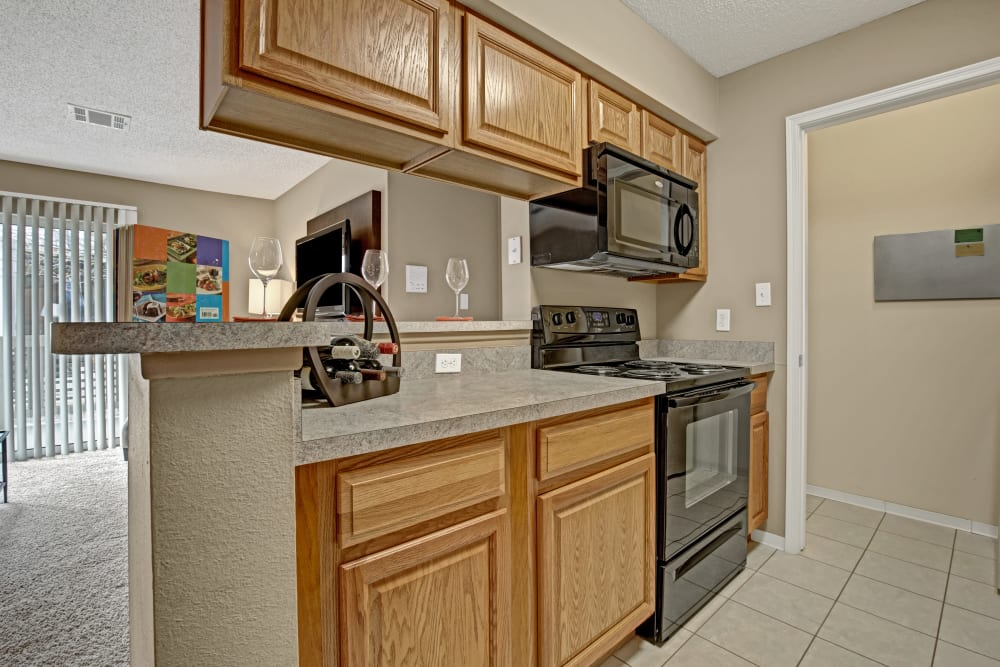 View of the kitchen bar through to the living room at The Lakes of Schaumburg in Schaumburg, Illinois