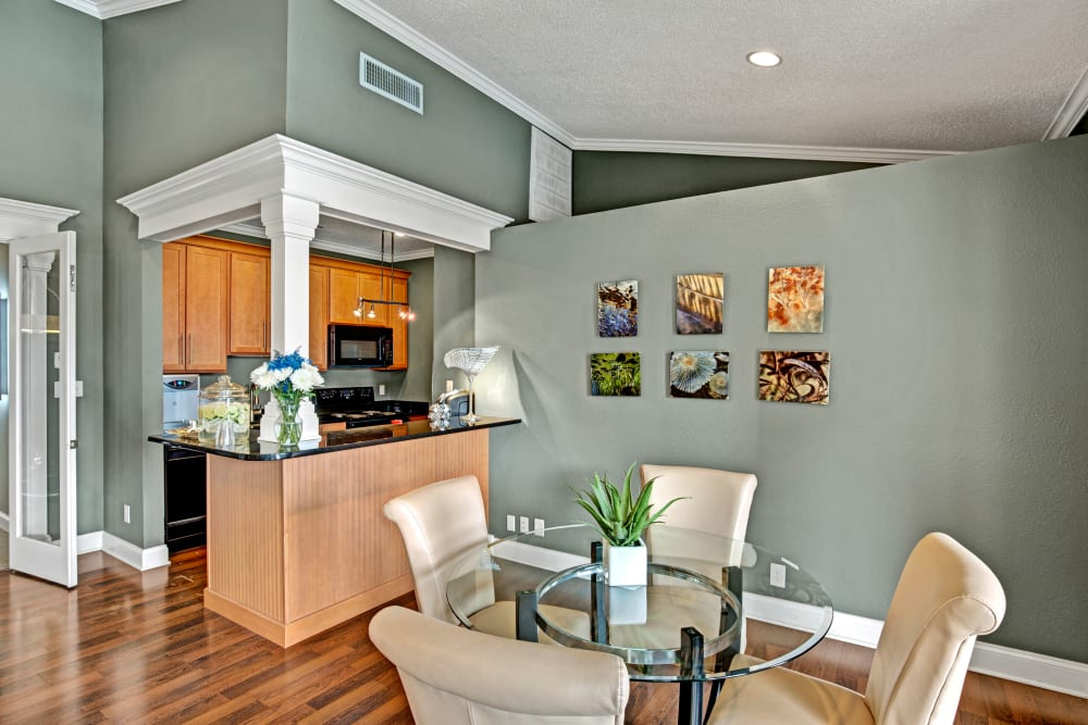 Open concept floor plan with hardwood floors and modern decor at The Lakes of Schaumburg in Schaumburg, Illinois