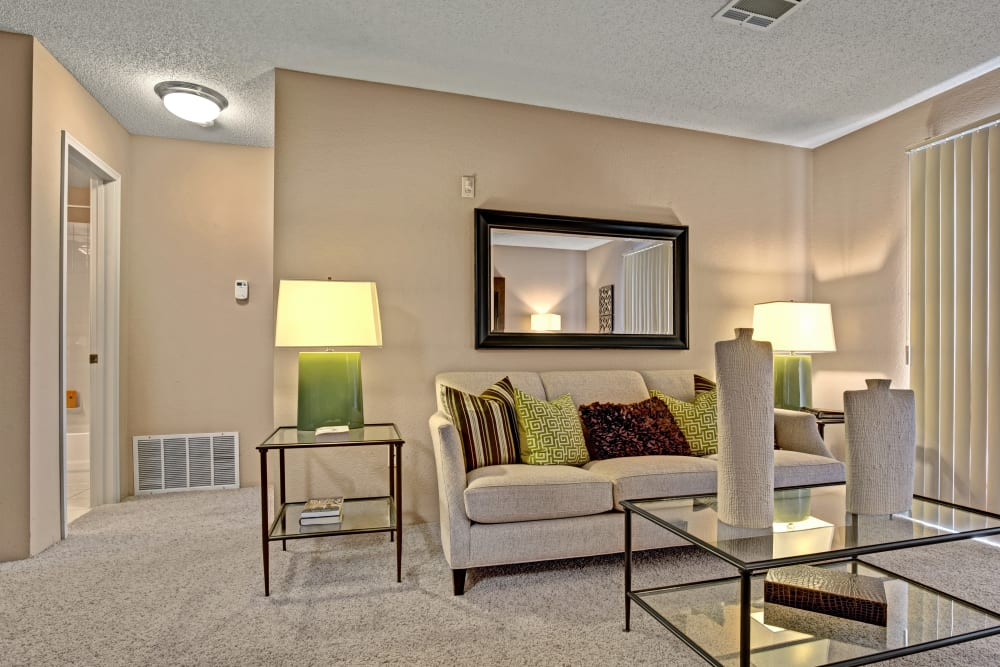 Living room with modern Decor with a view of the hallways at The Lakes of Schaumburg in Schaumburg, Illinois